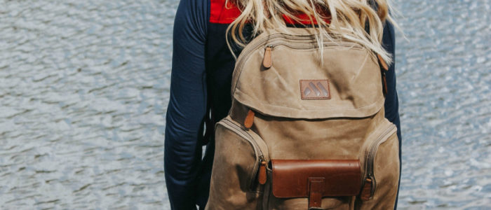 woman wearing machir causual backpack khaki